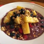 One of my favorite power breakfasts, an acai bowl, made with almond or cashew milk, acai puree, berries, and gluten-free granola.